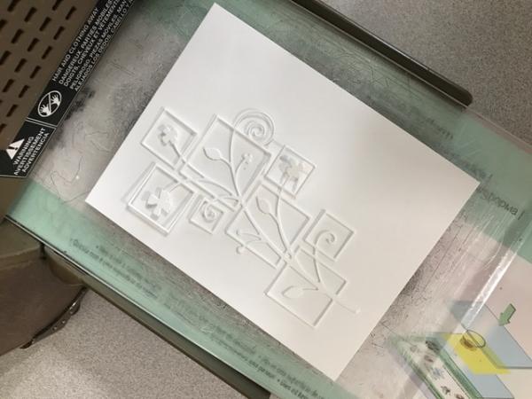 Starlitstudio embossed die on watercolor cardstock in machine